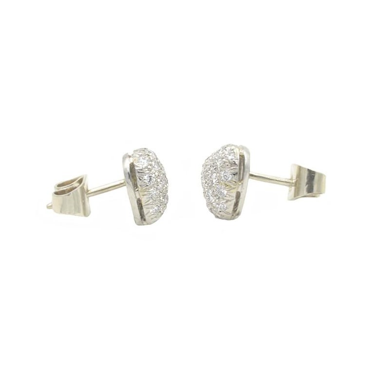 Oscar Heyman heart shaped diamond pave stud earrings.  Approximately 1 carat total weight in G-H VS round brilliant cut diamonds.  8.3mm high and  9.2mm wide.  Set in platinum with 14k white gold backs.  Circa 1990