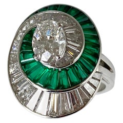 Oscar Heyman Platinum Emeralds and Diamonds Swirl Ring