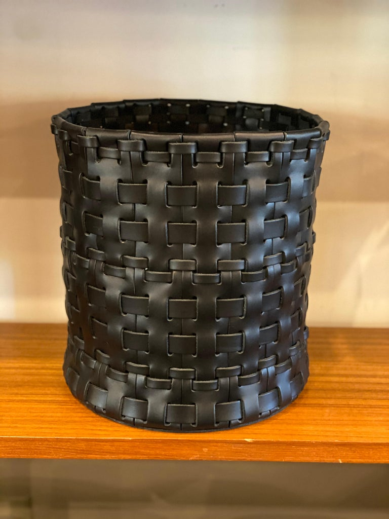 Handmade woven leather wastebasket by Oscar Maschera. Three baskets available in color elm and one available in black.