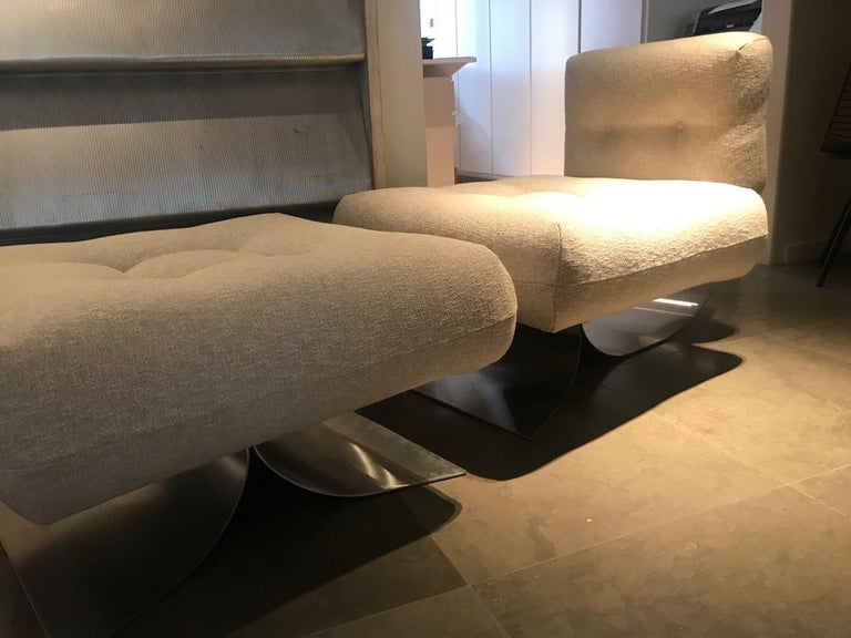 """Oscar Niemeyer, (1907-2012)  Single armchair and ottoman model """"Alta"""" Manufactured by Mobilier International France, 1974 Steel, wool upholstery."""