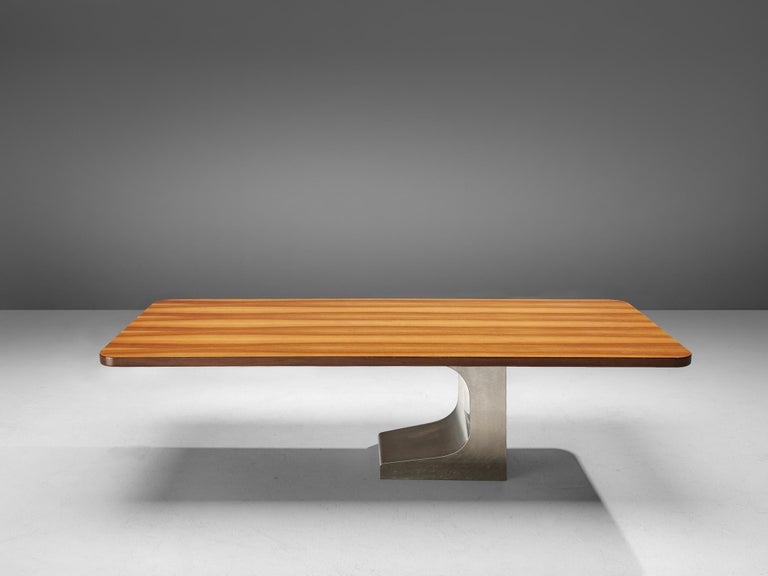 Oscar Niemeyer, table, Italian walnut, brushed steel, Brazil, 1980s  This first version Oscar Niemeyer table with a walnut tabletop has a sculptural satin stainless steel base. Designed as an 'executive desk' its shape also allows it in use of a