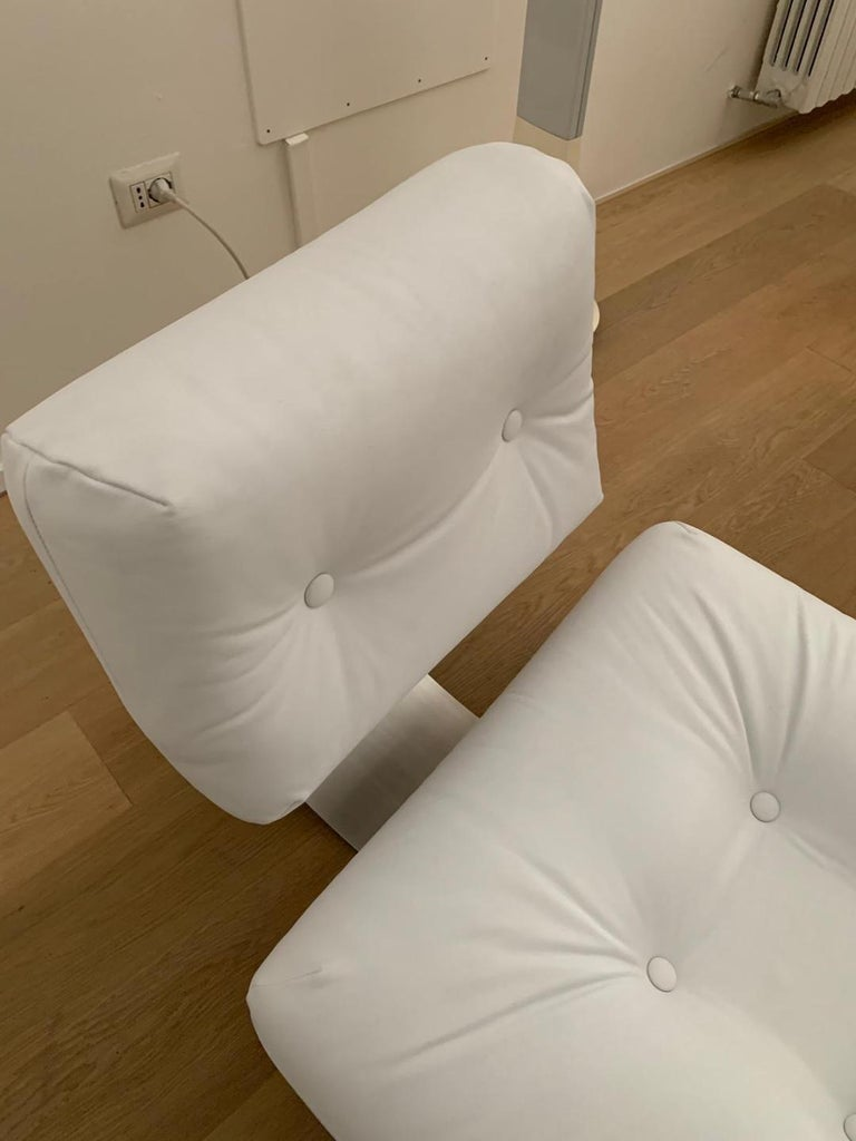 Stainless Steel Oscar Niemeyer White Armchair and Ottoman