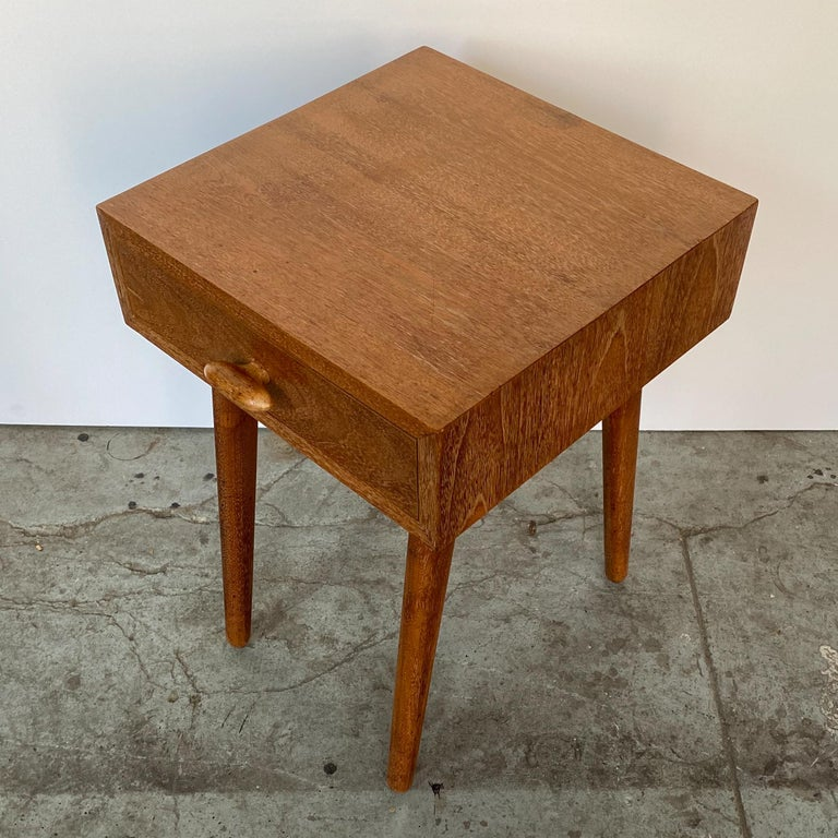 Nightstand in silvered walnut by the team of German-born American architects Oscar Stonorov and Willo von Moltke, designed for the Museum of Modern Art's 1941 Organic Design in Home Furnishings competition, and produced in very small numbers by Red