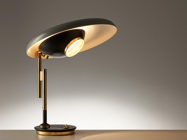 Oscar Torlasco for Lumi, table lamp model '555', metal, brass, Italy, 1950s  Refined desk light by Italian designer Oscar Torlasco. The light consists of a round base in black coated metal with a bottom in brass. The stem consists of two staggered