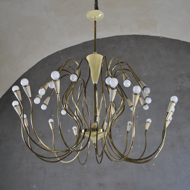 Monumental italian chandelier by Oscar Torlasco from 1950s with 30 lights in brass and aluminum.