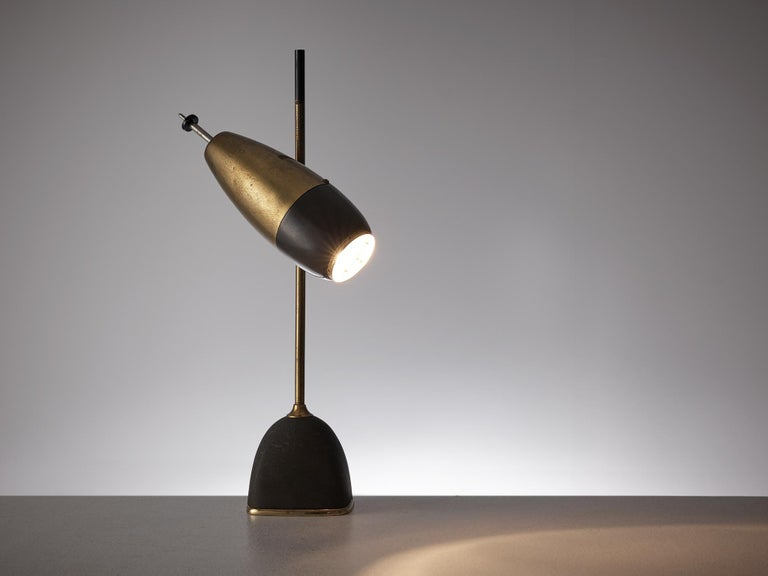 Oscar Torlasco, table lamp, metal and brass by Italy, 1960s.  Refined small desk light by Italian designer Oscar Torlasco. The light consist of a dark base with a brass bottom. The slim stern is also executed in brass with a black top. Halfway the