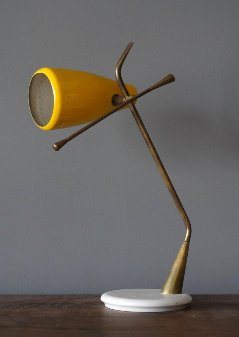 A rare desk light / table lamp. Designed by Oscar Torlasco, produced by Lumen Milano, Italy, 1950s.  Features yellow lacquered metal, brass, and marble.  Other designers and makers of the period include Angelo Lelii, Stilnovo, Max Ingrand,