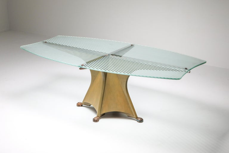 Gaudi inspired dining table by Oscar Tusquets Blanca, Spain, 1985 Free flowing Catalan post-modernism. Painted wooden base, etched glass top and bronze feet. Manufactured by Casas. (This is the first edition of this model as it was later produced