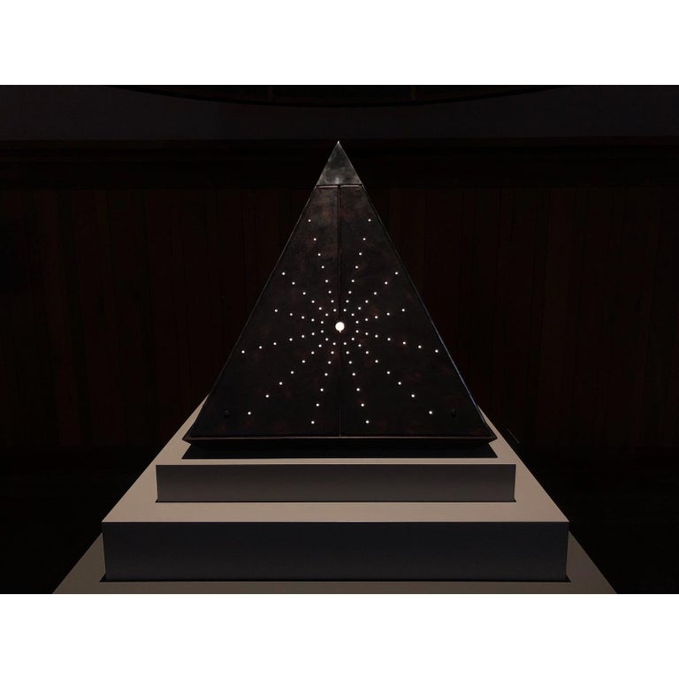 Starry Pyramid by Oscar Tusquets and Pere Ventura for Exhibition-event Homo Faber celebrada en Venezia septiembre 2018.  Limited edition of 8  A pyramid shaped tabernacle. Leather covered faces, coarse and masculine on the outside, delicate and