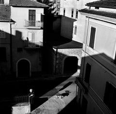 Dog and Shadow, Atina, Italy, black and white photo, contemporary Italian town