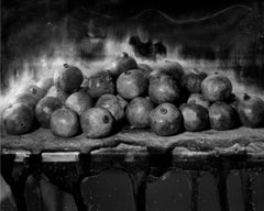 Feast, Silver gelatin print still life photo of pomegranates on a table