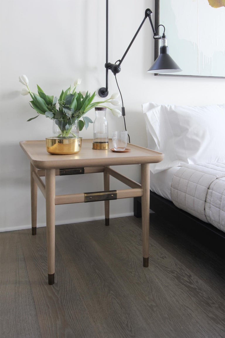 Oslo side table possesses a simple, enduring purity. With rectangular scooped tops, eased edges, and pops of brass, all are smooth to the touch and pleasing to the eye. At home in formal or informal settings, it is the perfect partner to both
