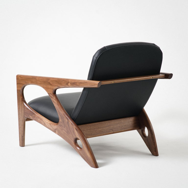 Modern Osprey Lounge Chair with Walnut Frame and Leather Upholstery For Sale