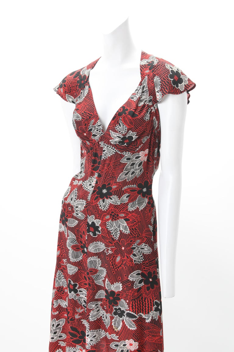 Ossie Clark Celia Birtwell Printed Dress c. 1970s Worn by Julia Roberts in 1997 Conspiracy Theory; Empire dress with self ties at neckline and zipper back; Printed abstract floral motif in red, black and white.