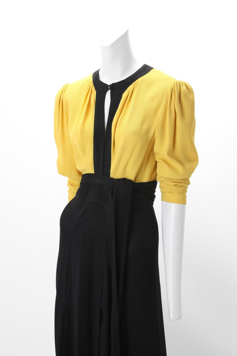 Ossie Clark Moss Crepe Wrap Dress c. 1970s UK 38; Black and Yellow Color Block Wrap Dress with Self Ties; Rouleau Button at front and back neckline.