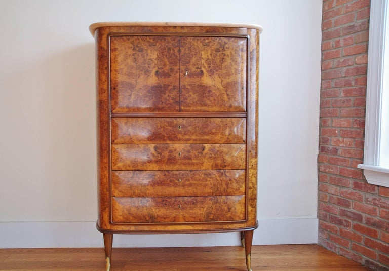 Osvaldo Borsani attributed Italian cabinet, secretaire, circa 1945-1950. Rounded burl structure with frame, pink marble top. It features two doors and bottom drawers all with keys. The front doors with key open up to reveal parchment compartments