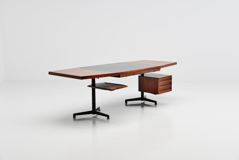 Fantastic large and very early conference desk designed by Osvaldo Borsani and manufactured by Tecno, Italy 1954. This large desk has a sliding table on the left and a drawer unit on the right with 3 drawers in it. In the middle underneath the top