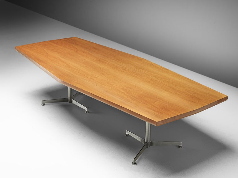 Osvaldo Borsani for Tecno, dining table, mahogany, metal, Italy, 1950s.  Excellent designed mahogny conference table by Osvaldo Borsani for Tecno. This table is in line with the well-known 'boomerang' desk. The tabletop shows the beautiful grain