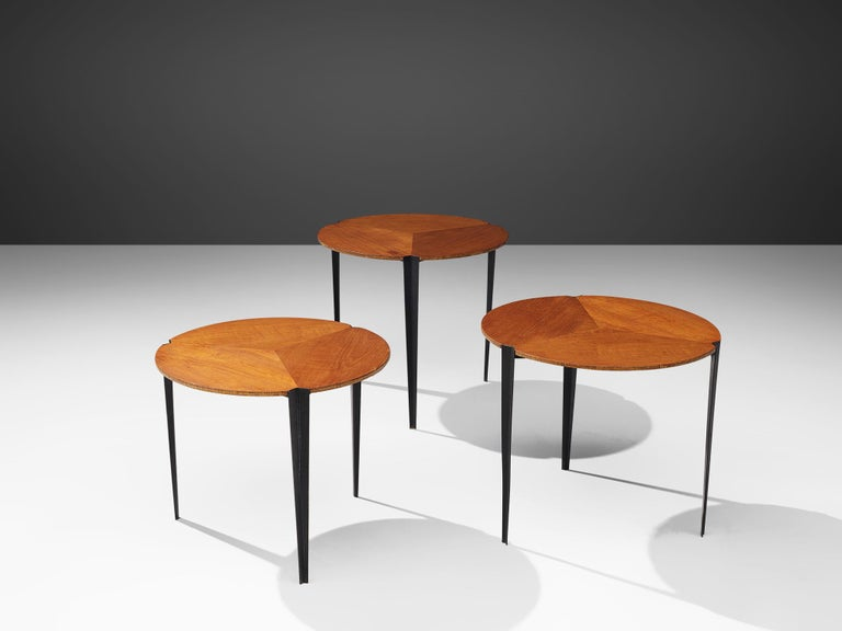 Osvaldo Borsani for Tecno, set of three nesting tables model 'T61', teak and metal, Italy, 1957  Elegant set of three nesting tables, designed by Osvaldo Borsani and produced by Tecno. Each table has a circular table top of teak veneer, that is