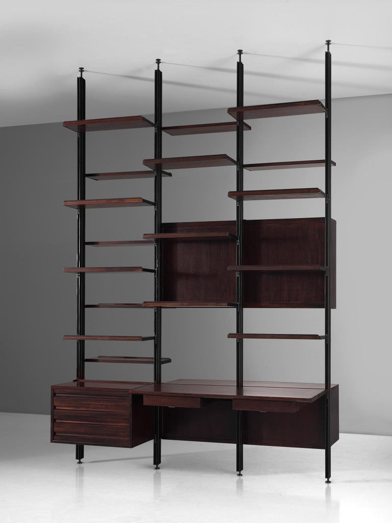 Osvaldo Borsani for Tecno, room divider, metal and darkened wood, Italy, 1950s.  This freestanding shelving unit of three sections on front and back, can be used as a bookcase and a room divider as well. The system was developed by Borsani as