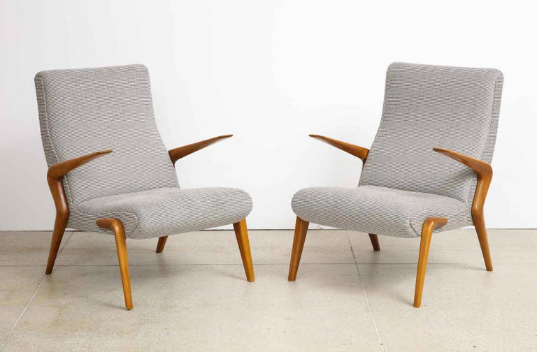 P71 Lounge Chairs by Osvaldo Borsani for Tecno.  Opern arm lounge chairs of bleached walnut and upholstered seat and back.  Wood has recently been refinished and newly upholstered seats.   Provenance:  Private Collection Bergamo Published:  Osvaldo