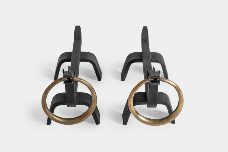 Designed by Osvaldo Borsani and manufactured by ABV Arredamenti Borsani-Varedo, pair of figural wrought iron andirons with brass details. 