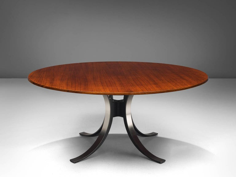 Osvaldo Borsani and Eugenio Gerli for Tecno, T-69 dining table, rosewood, steel, Italy, 1965.  Round dining table with rosewood top and metal base. Characteristic on this table is the base. Consisting of four C-shaped legs. These semicircles