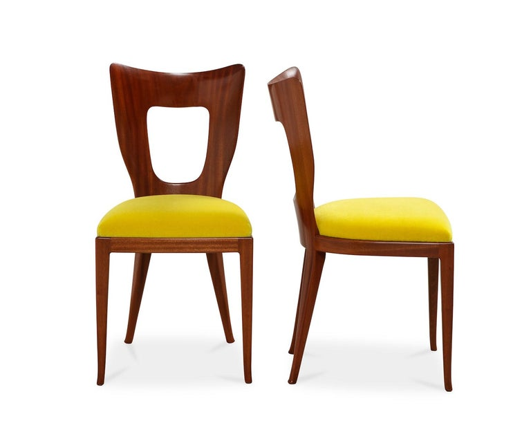 Elegant and sculptural dining chairs of solid mahogany. Currently only 2 chairs have been restored. Price quoted includes full restoration of all 12 and upholstering in fabric supplied by buyer. This model was first presented at the 1951 Triennale