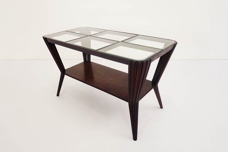 Osvaldo Borsani style elegant coffee table with fine carved wood.