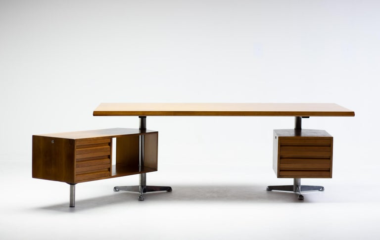 Fantastic desk designed by Osvaldo Borsani for Tecno, Italy. Beautiful gold colored Italian walnut. The floating top sits on tripod aluminium bases with articulating right side storage cabinet which features three drawers.  Additional return