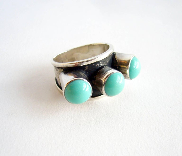 Sterling silver and turquoise ring created by master sculptor, painter and jeweler, Oswaldo Guayasamin of Ecuador.  Ring is a finger size 7 and is signed GuayasaminIn, 900.  In very good vintage condition.