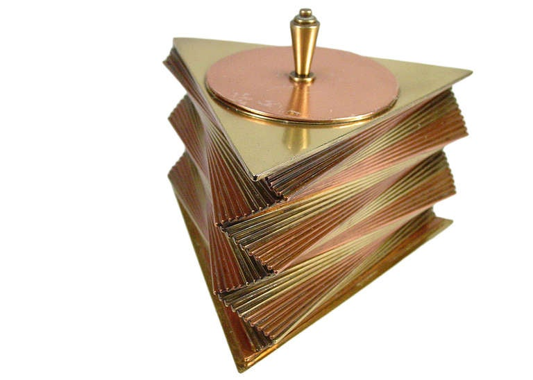 This rare 1935 all-original decorative box was designed and produced by John Otar in California. The box features individual triangular brass and copper plates stacked to create a spectacular, twisting spiral form. It is signed on the bottom, inside