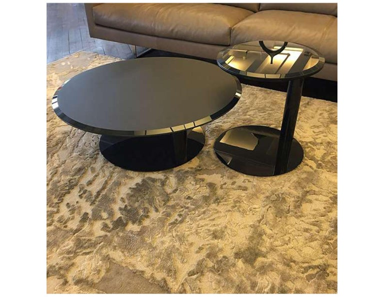 Oto mini coffee table Measures: 90cm diameter x 32cm high Top - satin blue-grey painted glass with bevel Base - blue-grey lacquered metal Original price: $2,680  Oto mini side table Measures: 45cm diameter x 50cm high Top - bright blue-grey