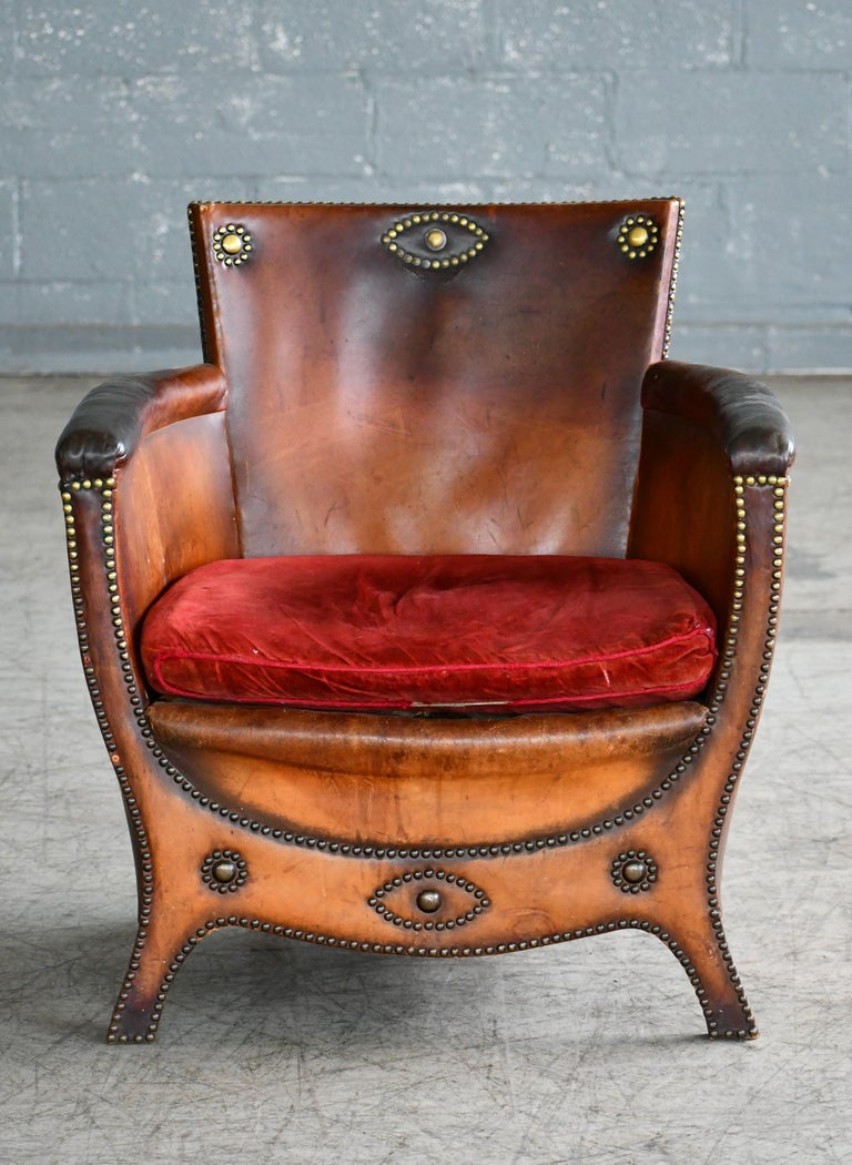 Superb 1930s-1940s baroque-style lounge chair attributed to Otto Schulz designed for Boet - Schulz' own high-end retail store in Gothenburg, Sweden. The chair in leather and birch wood is very representative of his innovative low swung baroque