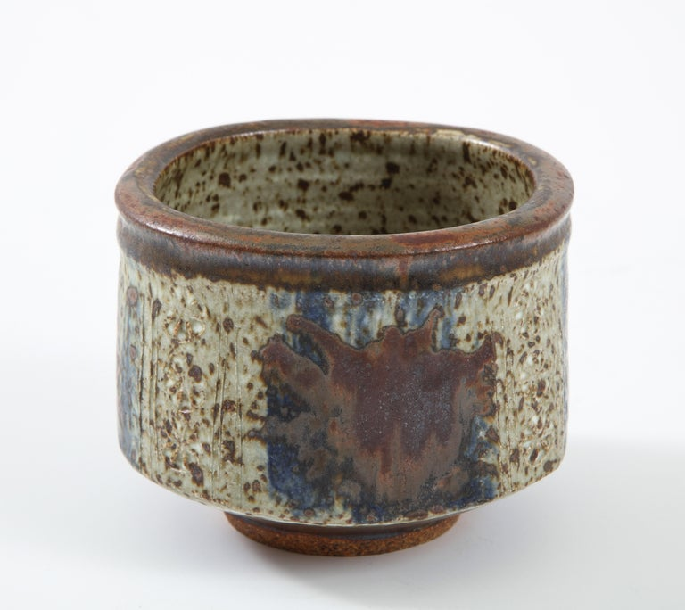 Otto & Vivika Heino stoneware bowl, b. Finland, California Potters, stoneware ceramic vessel, Squircle shape, hand formed with blue and rust colored glazes, signed. California, circa 1970.