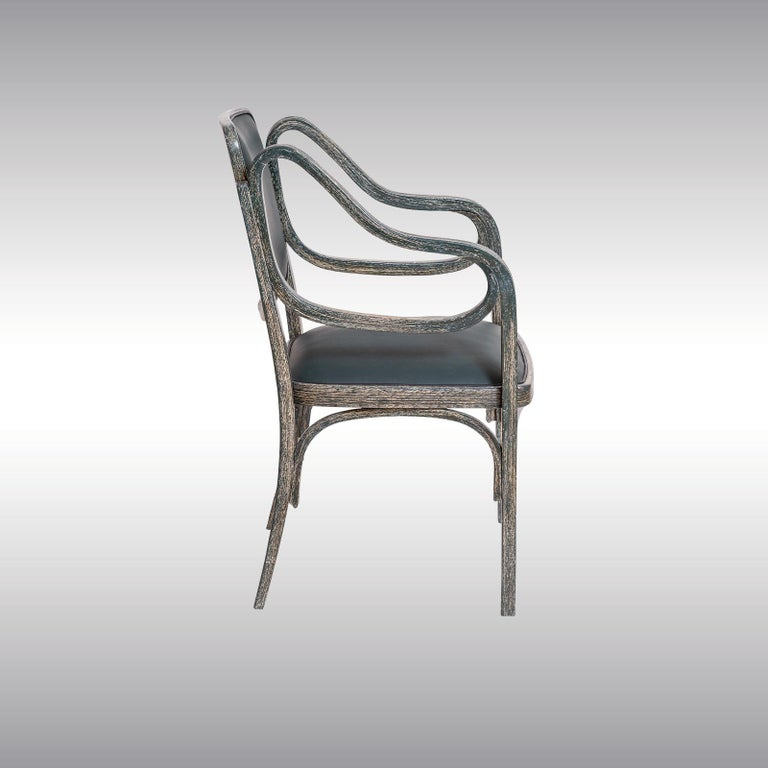 As pioneer and master of the Modern, Otto Wagner seized the then rather new technique of bending Wood for his furniture designs. The design of this armchair dated back in 1901. This particular chair was manufactured at Mundus circa 1906. Especially