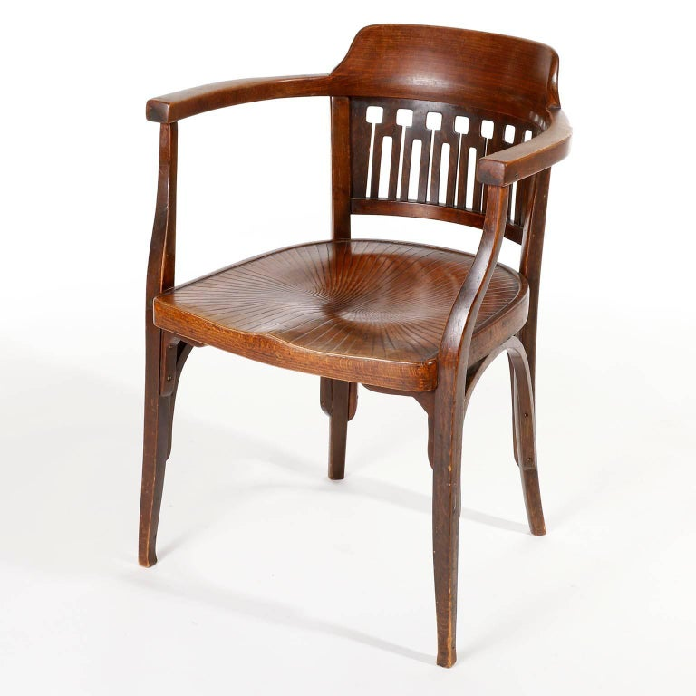 A Vienna Secession bentwood armchair by Otto Wagner and manufactured by Jacob & Josef Kohn (J. & J. Kohn), Austria, circa 1900.  This chair is an authentic piece which is in great original condition with nice patina. It is made of brown stained