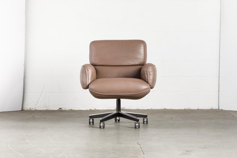 This gorgeous leather executive management desk chair is by Otto Zapf for Knoll International, circa 1985. Constructed of heavily cushioned sections, with the top head section and arms removable. The chair base is height and tilt / recline