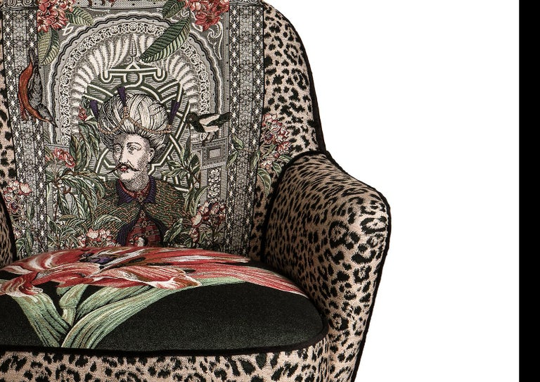 Elegant Italian Mid Century style armchair  with brass legs and ottoman and botanical theme fabric with back in black velvet. The Ottoman collection has been designed by Massimiliano Giornetti, long time creative director for Salvatore Ferragamo,