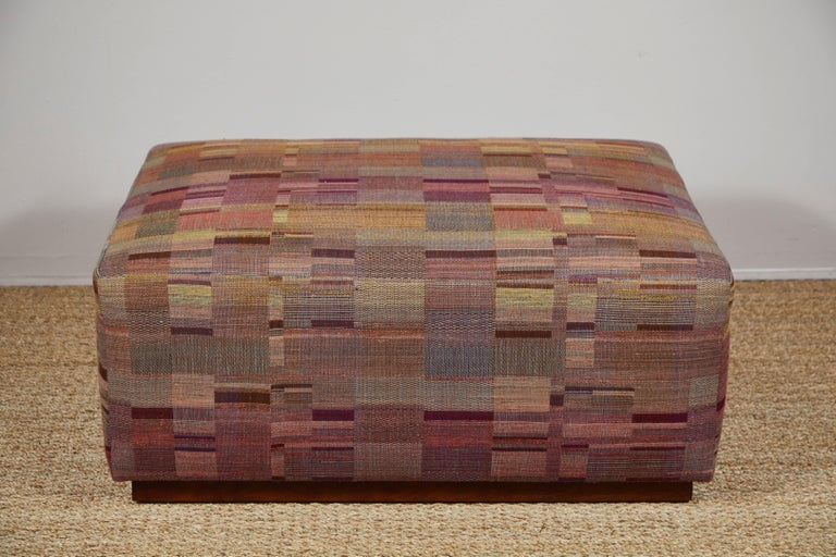 Contemporary ottoman on wheels covered in Pat McGann Studio raw tussar silk and wool fabric. Fabric and ottoman available to order.