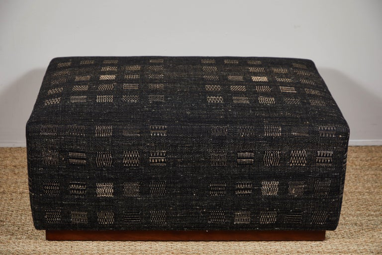 Contemporary ottoman on wheels covered in Pat McGann Studio raw tussar silk and cotton upholstery fabric. Upholstery weight fabric and ottoman available to order.