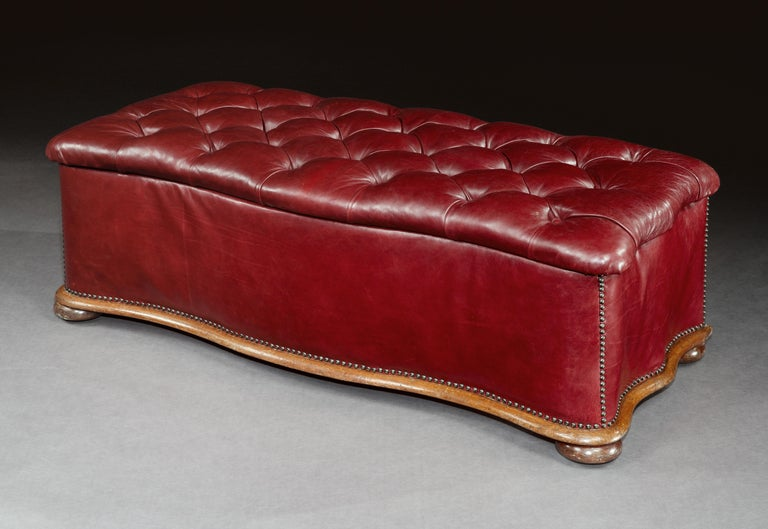 Serpentine-shaped ottoman, mid-19th century, English, Victorian, with mahogany skirt and feet and upholstered in burgundy leather  This handsome ottoman is really practical offering both seating and storage space. It is traditionally upholstered