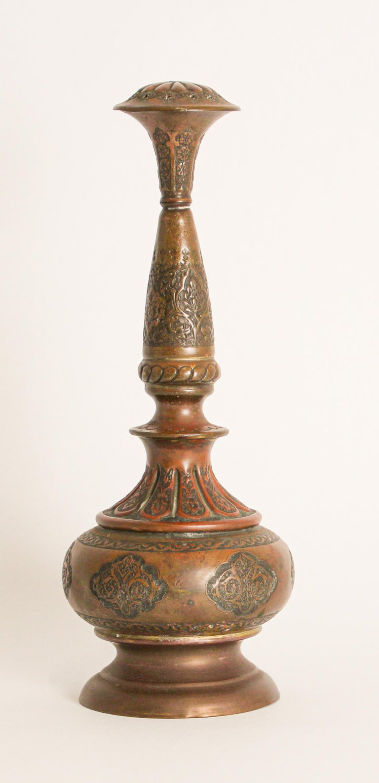 Turkey, 19th century, antique handcrafted ottoman Moorish decorative copper rosewater perfume sprinkler. Embossed and hand chased, engraved and punched decoration to body with floral and geometric Islamic Moorish designs with screw-able top with