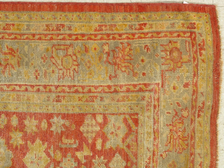 Turkish carpet from Oushak with a combination of soft colors having an all-over design. Finely woven, having the most superb wool found in the mountains of Anatolia. This is a fine example of an antique Oushak. Size: 6' x 9'2