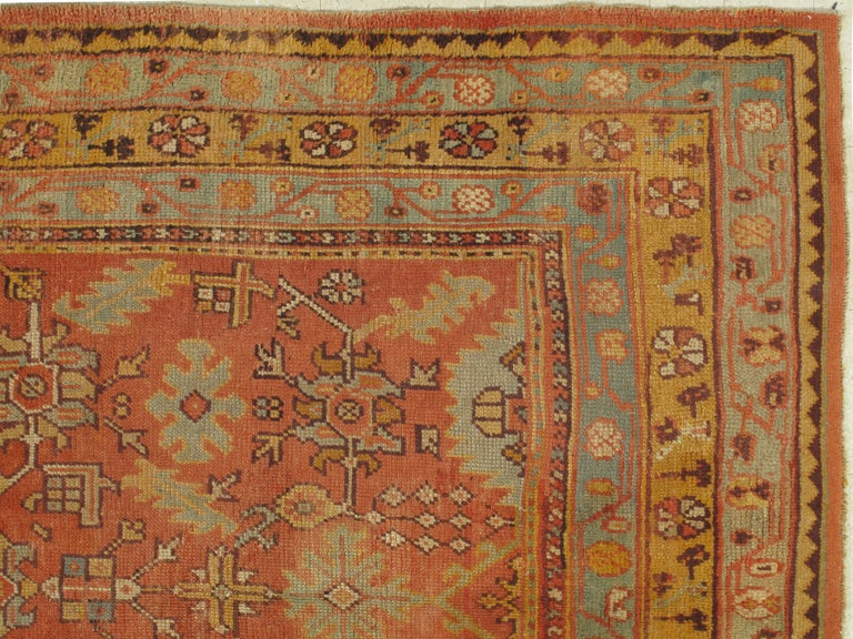 Turkish carpet from Oushak with a combination of soft colors having an all-over design. Finely woven, having the most superb wool found in the mountains of Anatolia. This is a fine example of an antique Oushak. Size: 7'3