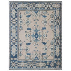 Oushak Rug from Mid-20th Century Turkey with Blue and Cream Tribal Design