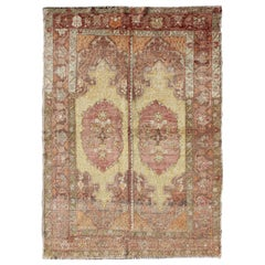 Oushak Rug with Two Medallion Panels in Yellow, Brown, Orange and Soft Red