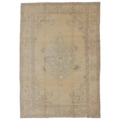 Oushak Vintage Turkish Rug with Faded Central Medallion Design in Cream Colors