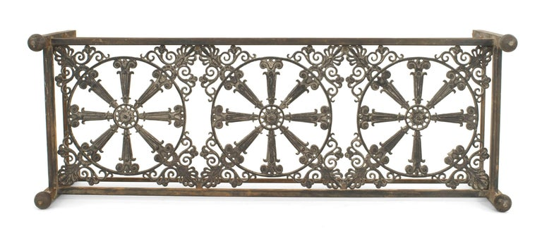 Outdoor continental style large iron base rectangular coffee table with a 19th century iron filigree railing as a shelf under a glass top.