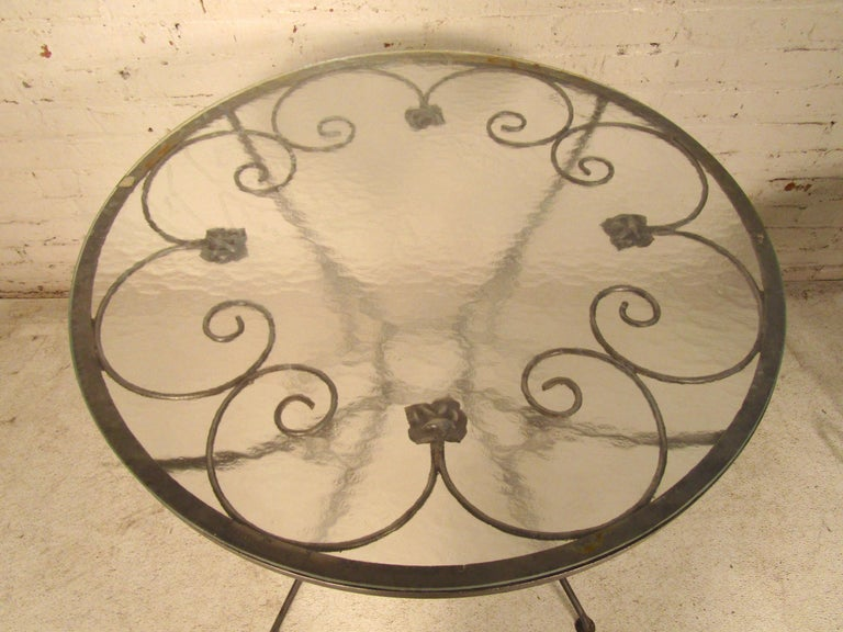 Metal patio table with glass. Attractive detailing and slender lines throughout. Refinished in a bare metal style finish. (Please confirm item location - NY or NJ - with dealer).
